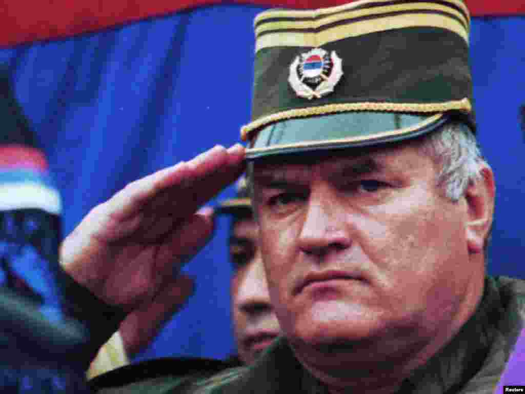 "Mladic salutes during the promotion of a new unit ""The Drina Wolfe"" in Vlasenica, northeast of Sarajevo, on December 2, 1995."