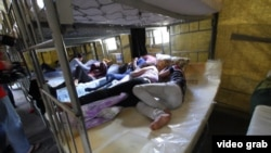 Suspected illegal migrant laborers inside a detention camp in Moscow on August 6.