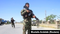 Afghan army soldiers at a check post during the Eid al-Fitr holiday.