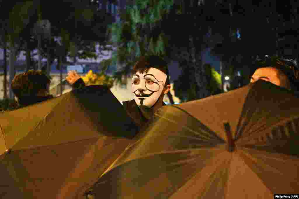 A protester wearing a mask takes part in a protest in the Wanchai district in Hong Kong on October 4. (AFP/Philip Fong)