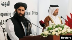 FILE -- Muhammad Naeem (L), a spokesman for the Office of the Afghan Taliban speaks during the opening of the Taliban Afghanistan Political Office in Doha (June, 2013).