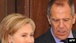 Russian Foreign Minister Sergei Lavrov speaks with U.S. Secretary of State Hillary Clinton in Moscow on October 13.