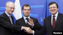 Russian President Dmitry Medvedev (center) is welcomed by European Council President Herman Van Rompuy (left) and European Commission President Jose Manuel Barroso ahead of the Brussels summit.