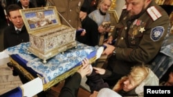 Russia -- Orthodox Christians surround a chest containing the Cincture of the Virgin Mary, held by priests and Cossacks, at the Pokrovsky cathedral in the Siberian city of Krasnoyarsk, 03Nov2011