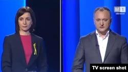 Кандидаты в президенты Молдовы Майя Санду (слоева) и Игорь Додон во время теледебатов.