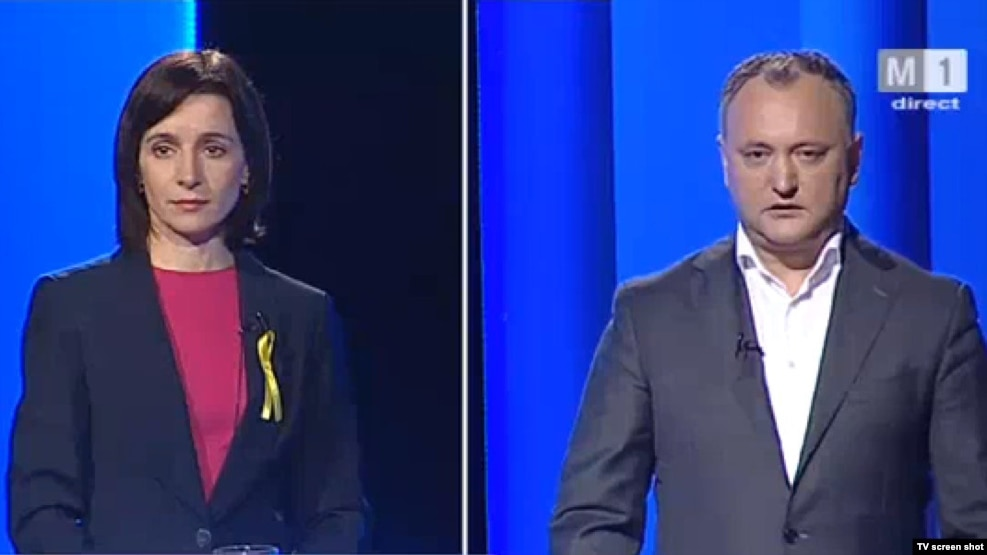 Presidential candidates Igor Dodon (right) and Maia Sandu