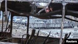 Сожженный протестующими автомобиль МВД. Киев, 20 января 2014 года.