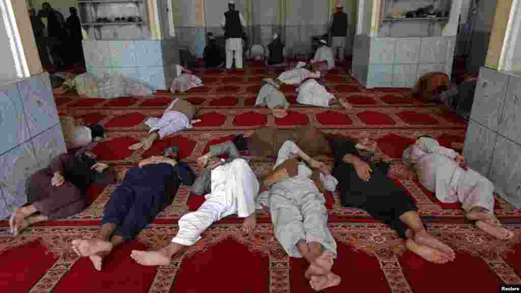 Afghan men sleep after prayer during the holy month of Ramadan at a mosque in Kabul on August 1. (REUTERS/Omar Sobhani)