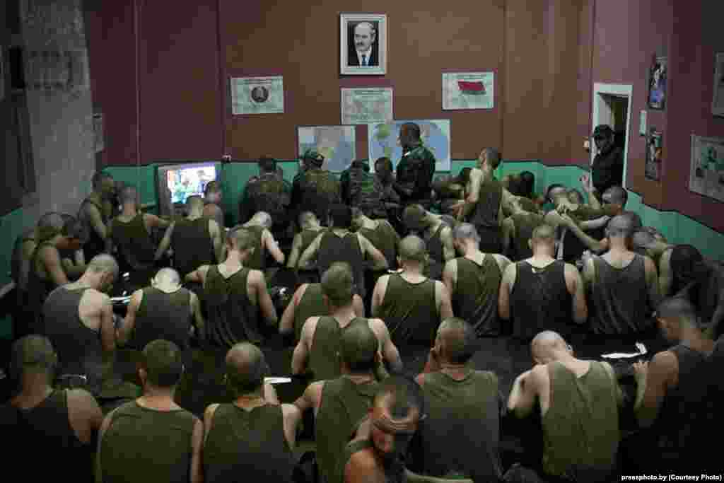 "Conscripts in Barysau in the Minsk region participate in the mandatory watching of the news program called ""Panorama"" on state-run TV. Photo by Syarhey Gudzilin"
