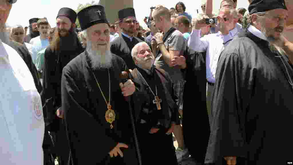 Serbian Orthodox Patriarch Irinej (second left) arrives to celebrate St. Vitus Day in Gazimestan.
