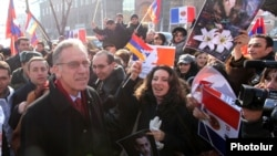 Armenia - Ambassador Henri Reynaud (L) is greeted by young Armenians demonstrating outside the French Embassy in Yerevan, 24Jan2012.