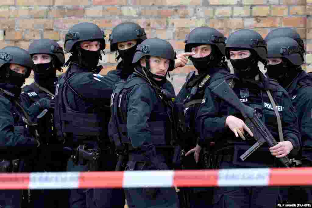 German police take up a position at the crime scene following a shooting attack near a Jewish Synagogue in Halle on October 9.