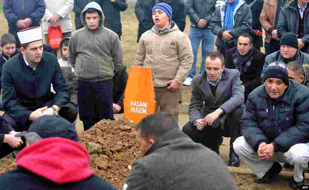 Sarajevo residents and family members pray during the burial ceremony on January 8 in front of the chapel at a Sarajevo cemetery.