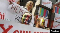 Activists demonstrate in support of Ukrainian TV Channel 5 outside a court building in Kyiv.