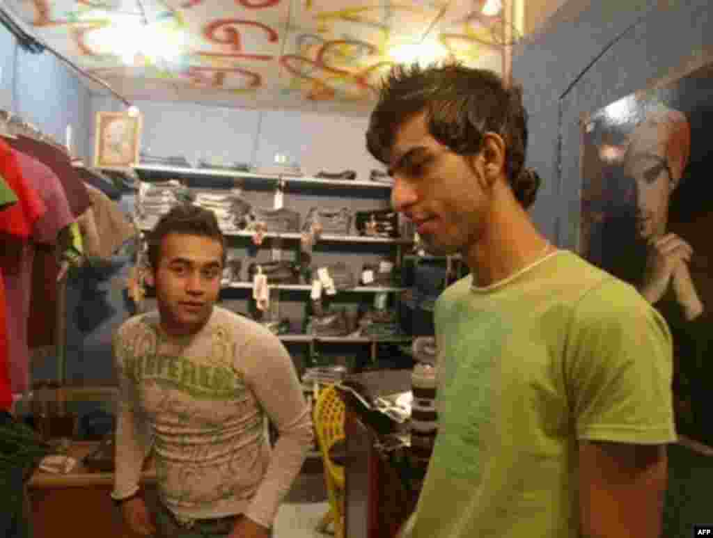 Iran's dress code prohibits men from wearing short-sleeve shirts or Western-style haircuts, but many fashion-conscious young Iranians, like these Tehran shopkeepers, choose to ignore the strict rules.