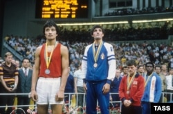 Silver medalist Serik Konakbaev (left) of the U.S.S.R. and gold medalist Patrizio Oliva of Italy during the awards ceremony for the men's light welterweight division at the 1980 Summer Olympics in Moscow.