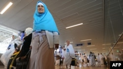 Pilgrims from Iran arrive at Jeddah airport in Saudi Arabia on October 30. More than 500 have now been sent back home, Iran says.