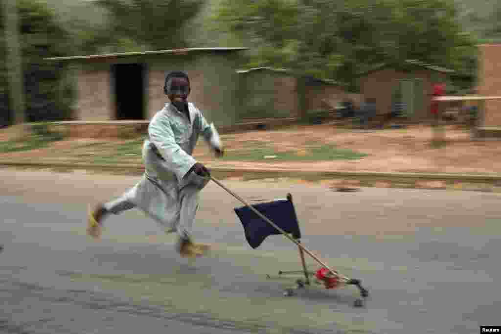 A boy runs with a homemade toy car in an area where some Muslims are still stranded due to the ongoing sectarian violence near Kilometre 12 in the Central African Republic's capital, Bangui. (Reuters/Siegfried Modola)