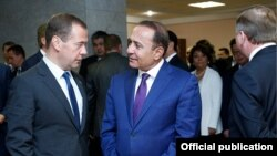 Belarus - Prime Ministers Dmitry Medvedev of Russia and Hovik Abrahamian of Armenia speak on the sidelines of a Eurasian Economic Union meeting in Grodno, 8Sep2015.