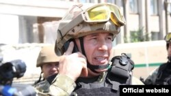 Ukrainian Defense Minister Valeriy Heletey in combat uniform in Slovyansk in July