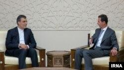 معاون عربی- آفریقا وزارت امور خارجه ایران (چپ) در دیدار با بشار اسد، رییس جمهوری سوریه.