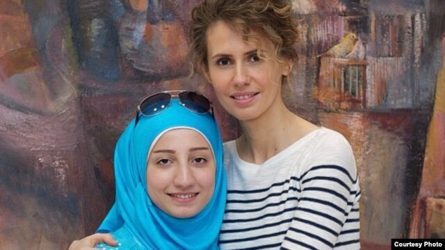 Assad posing with a Syrian business student in a picture posted on September 4.