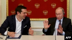 Greek Prime Minister Alexis Tsipras (left) speaks with Russian President Vladimir Putin during a signing ceremony at the Kremlin in Moscow in April.