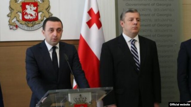 Giorgi Kvirikashvili (right) is set to replace Irakli Garibashvili (left) as the country's prime minister. (file photo)