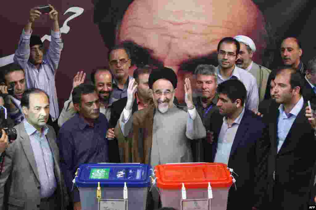 Former President Mohammad Khatami casts his vote at a polling station in Tehran.
