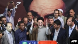 File photo - Former president Mohammad Khatami casts his vote at a polling station in Tehran, after supporting the first election of Hassan Rouhani. June 14, 2013