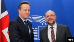 British Prime Minister David Cameron (left) is welcomed by President of the European Parliament Martin Schulz prior to meetings at the European Parliament in Brussels, Belgium, on February 15.
