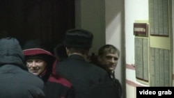 Syarhey Kavalenka (right) as he was escorted into the Vitebsk courtroom on February 24
