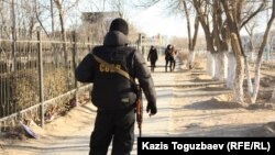 A police officer stands guard in Zhanaozen in the days after the December 2011 violence.