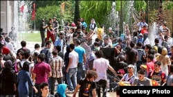 Young Iranians gathered to spray water on each other last week in Tehran.
