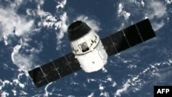 "The SpaceX ""Dragon"" capsule nears the ISS in this 2012 photo."