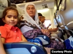 Tajik authorities removed 10-year-old Fatima Davlatova (left) and her grandmother (right) from an international flight just before takeoff.