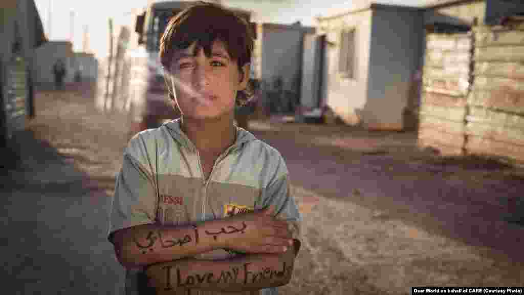 """I love my friends."" A boy at the Zaatari refugee camp in northern Jordan. Child labor is a problem among Syrian refugee children, many of whom do not go to school."