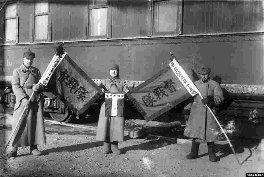 Russian communist fighters with captured Chinese flags during the 1929 Sino-Soviet conflict. The third problem with the hat was ideological: The Russian nationalism evoked by the budyonovka's shape didn't fit with the Bolsheviks' global ambitions to unite workers of the world in a communist revolution.
