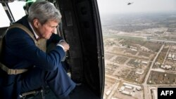 U.S. Secretary of State John Kerry looks out over Baghdad from a helicopter during a visit to the Iraqi capital on September 10.