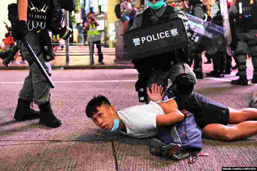 Police officers detain protesters during a rally against a new national security law on the 23rd anniversary of the establishment of the Hong Kong Special Administrative Region in Hong Kong, China, 01 July 2020. The new national security law, that Beijing has tailor-made for Hong Kong, prohibits acts of secession, subversion, terrorism and collusion with foreign forces to endanger national security. EPA-EFE/MIGUEL CANDELA
