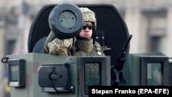 A Ukrainian soldier rides with a Javelin antitank missile in a Kyiv parade in August 2018.
