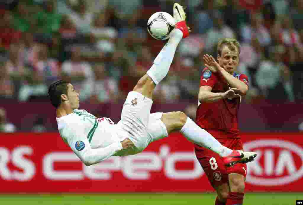 Portugal's Cristiano Ronaldo (left) in action against David Limbersky during a Euro 2012 quarterfinal match against the Czech Republic in Warsaw on June 21. Ronaldo scored the only goal in Portugal's 1-0 victory. (epa/Oliver Weiken)