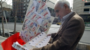 A man reads a campaign pamphlet in central Tehran ahead of Iran's 2012 parliamentary elections.