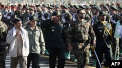 President Mahmud Ahmadinejad reviews Basij troops at a military base during Basij Week.