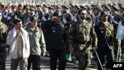 President Mahmud Ahmadinejad reviews Basij troops at a military base during Basij Week.