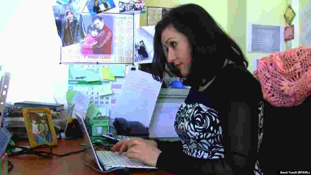 Komilzoda working in her office in Dushanbe