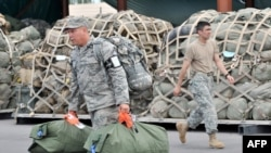 U.S. soldiers before boarding a plane to Afghanistan from the U.S. transit center at Manas.