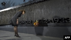 Ukraine's first lady Maryna Poroshenko attends the unveiling in Washington of a monument to the victims of the Ukrainian famine of the 1930s.