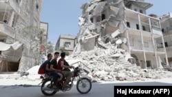 İdlib qəzasında dağıdılmış şəhərlərdən birində