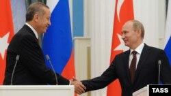 Ռուսաստանի նախագահ Վլադիմիր Պուտինը եւ Թուրքիայի վարչապետ Ռեջեփ Էրդողանը Մոսկվայում կայացած համատեղ ասուլիսի ժամանակ, 18-ը հուլիսի, 2012թ.
